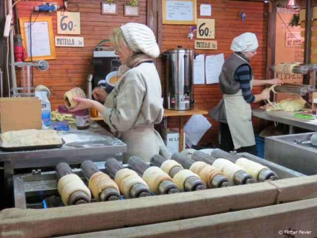 Get a Trdelník (Czech sweet pastry roll) with nutella or sugar at a market stall Prague