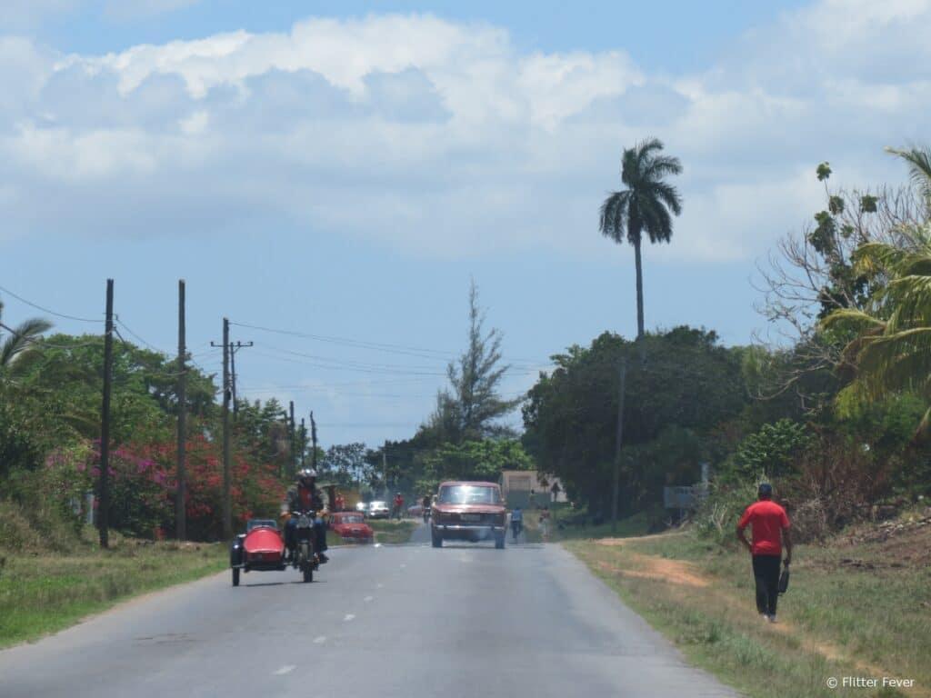 Sidecar, car, walking road Cuba