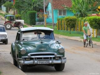Green oldtimer in Vinales Cuba