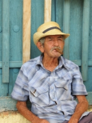 Old man smoking cigar in Trinidad