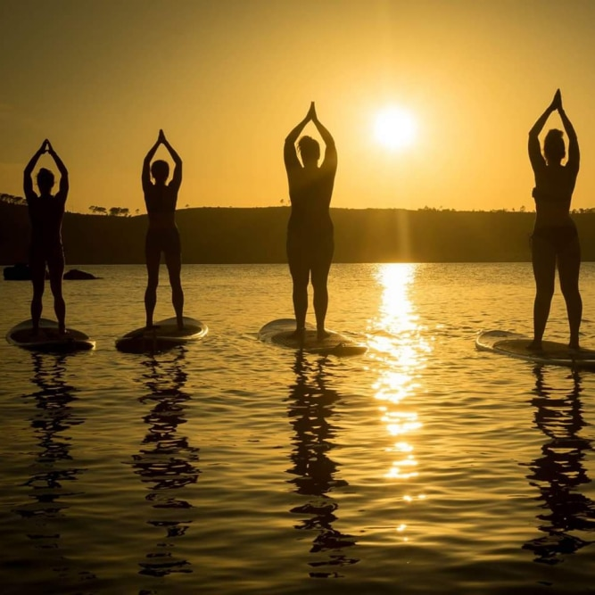 SUP yoga at sunrise