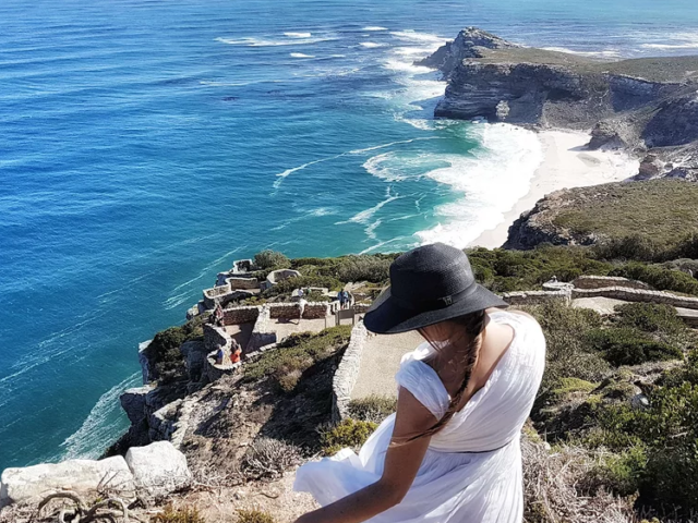 Naomi showing one of her favorite hats and a beautiful coastline