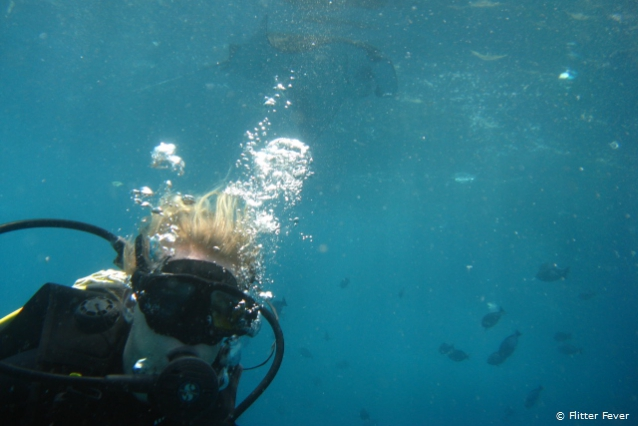 My friend and travel buddy Diny with a manta ray on the background