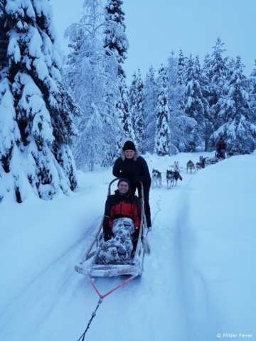 On our husky sledge in Finnish Lapland