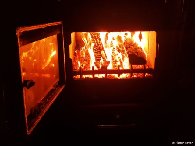 Warming up by the fire in the wooden cabin as it's so freaking cold out there