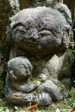 Sculpture with baby at Otagi Nenbutsu-ji, Kyoto