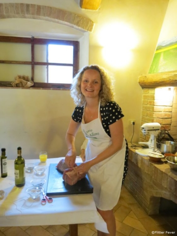 Preparing meet at cooking class at agriturismo in San Gimignano