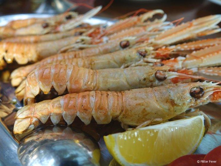 Big, fresh, grilled scampi at Duga Bay near Trogir