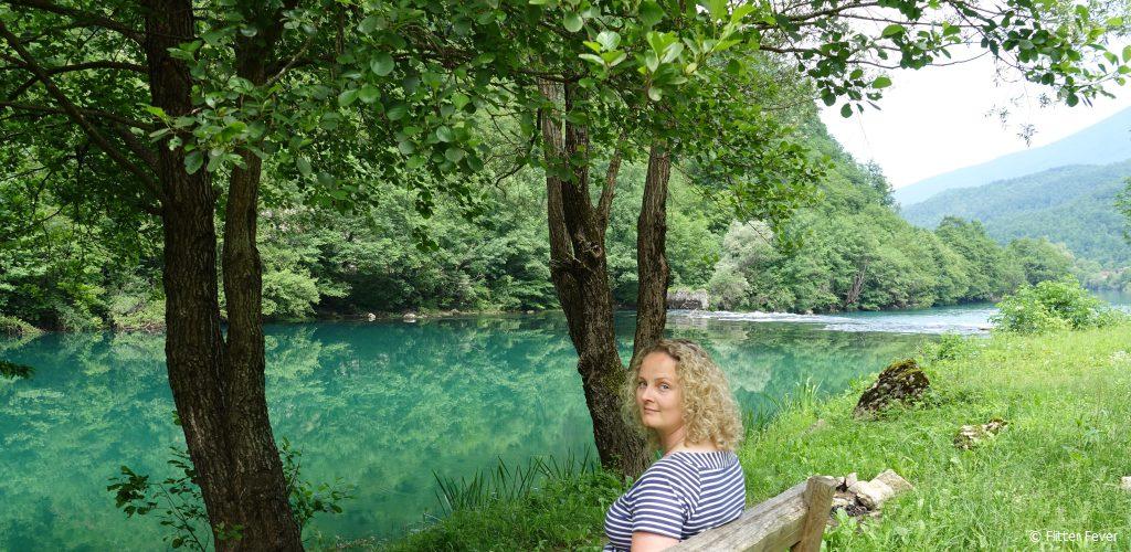 Sitting by the bright blue Una River in Bosnia Herzegovina