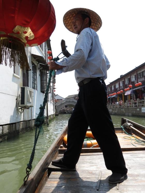 Chinese gondolier in Zhujiajiao, China