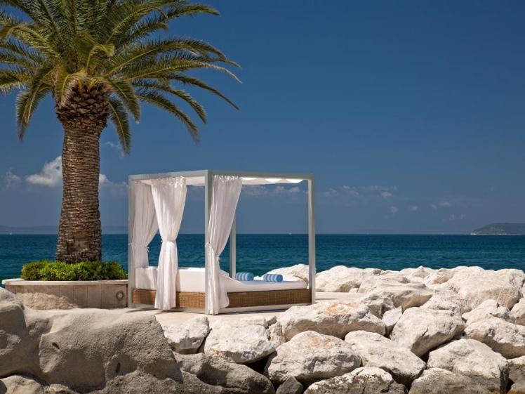 Le Meridien Lav lounge bed under palm tree