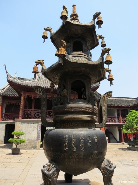 Traditional sacrifice pot tower in temple garden in Zhujiajiao