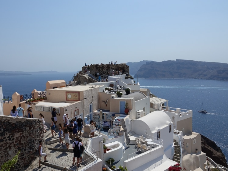 Santorini Castle and surrounding paths full of tourists