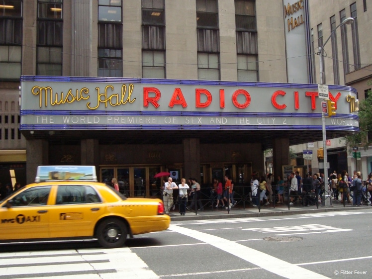 Radio City Music Hall NYC with taxi in front