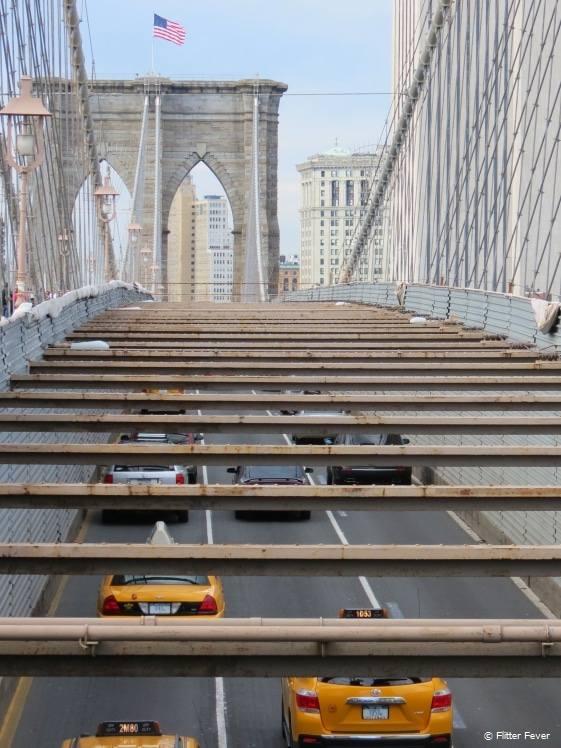 Taxis crossing the Brooklyn Bridge seen from above