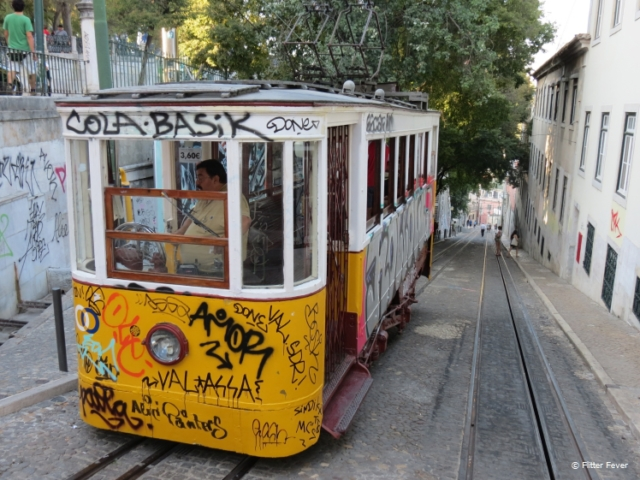 Elevador da Gloria covered by ugly graffiti in Lisbon