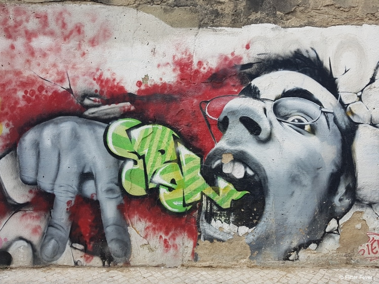 Screaming guy street art Lisbon