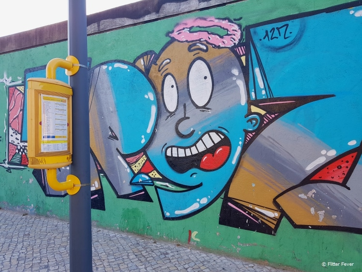 Street art at the bus stop in Lisbon