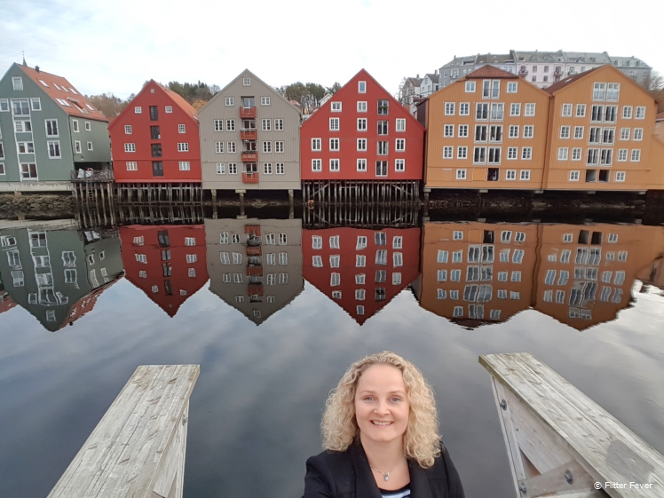 Reflection on water colorful storage houses Trondheim