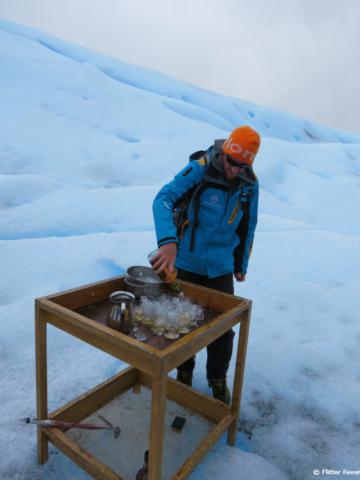 Our wonderful guide pooring whiskey with glacier ice