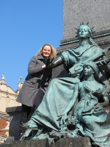 Muse of Poetry with child at the Adam Mickiewicz Monument on Rynek Główny