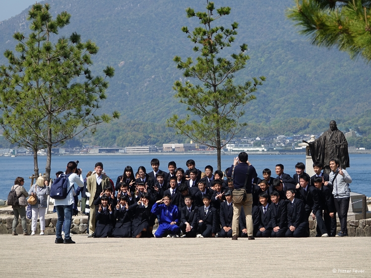 Japanese school kids at Taira No Kiyomori statue, the benefactor of the Itsukushima Shinto Shrine (12th Century)