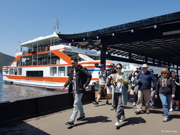 Tourists coming off the Miyajima ferry