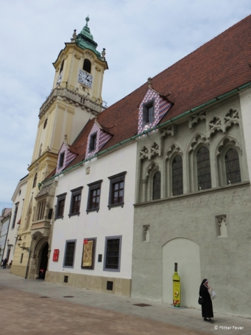 Jesuit Church (Juzuitsky kostol) with nun and Old Town Hall in Bratislava