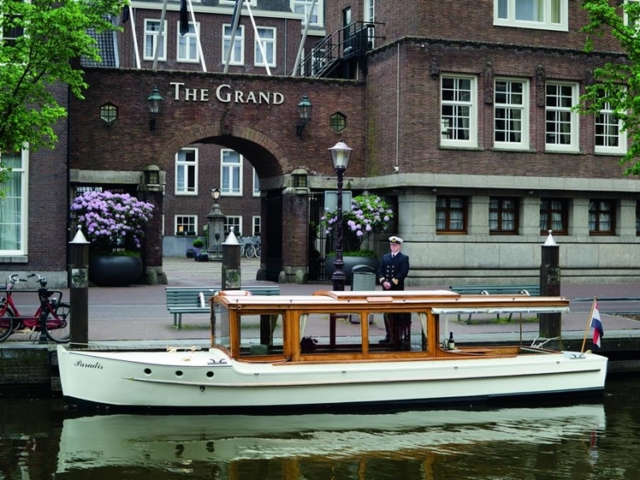 The Grand canal boat Amsterdam