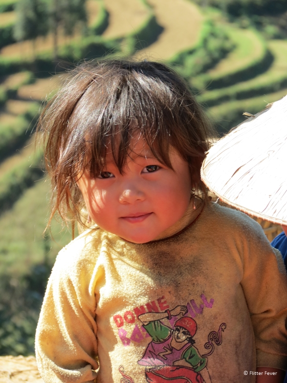Cute little girl at Can Cao market Vietnam Sapa