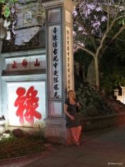 Main entrance gate to the Ngoc Son Temple at Hoan Kiem Lake Hanoi around sunset