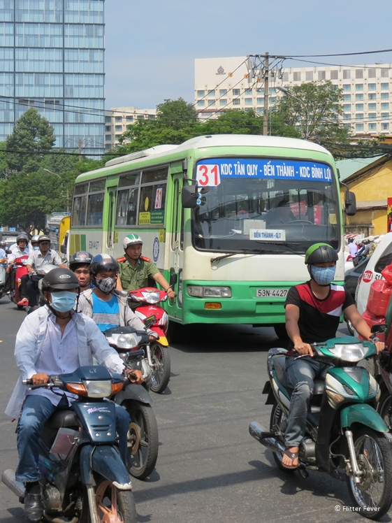 Scooters and bus in Ho Chi Minh City