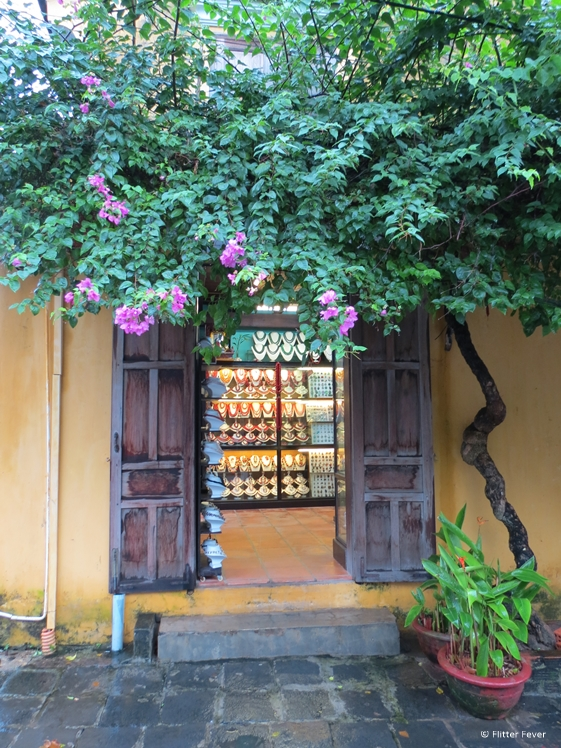 Shop with old wooden shutters in Hoi An