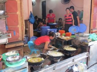 Street food stall in the old Quarter Hanoi Vietnam