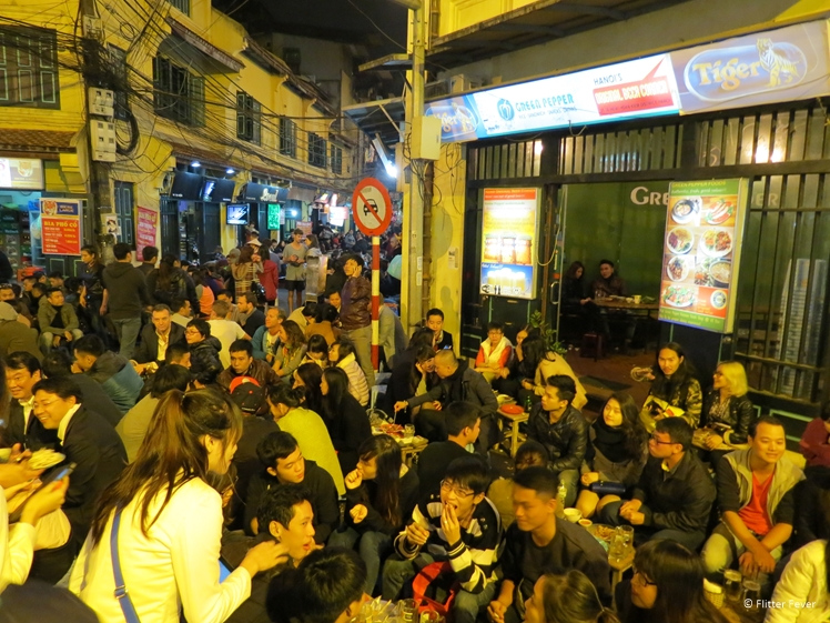 Trying to find an empty seat at Bia Hoi junction (Old Quarter)`Hanoi Vietnam