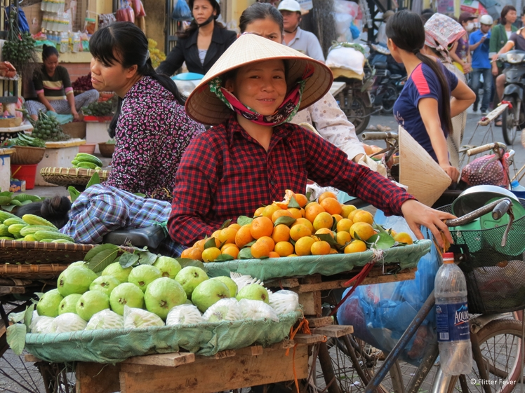 Vietnamese lady with fruit at Duong Xuan market in Hanoi
