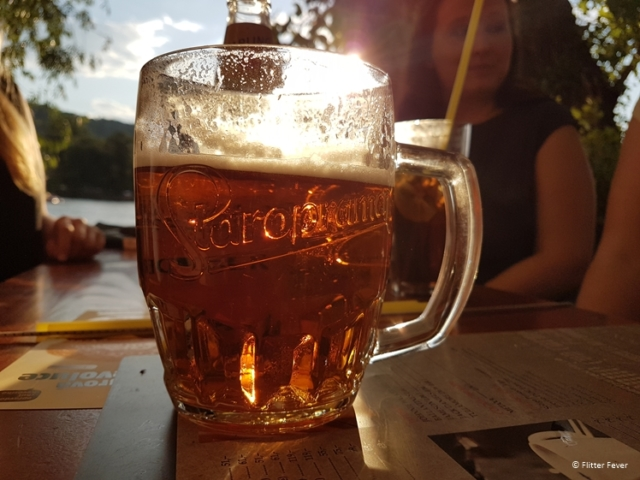 Beer with friends on a sultry summer night at River Cafe in Prague