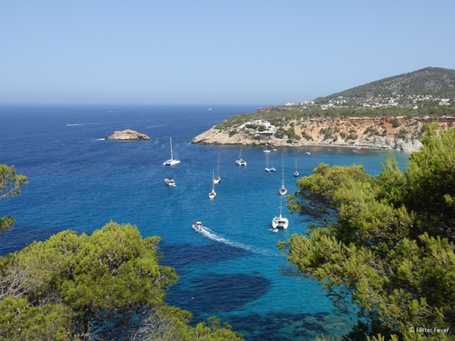 Crystal clear turquoise water of Port Brut at Cala d'Hort, Ibiza (seen from Es Vedra view point)