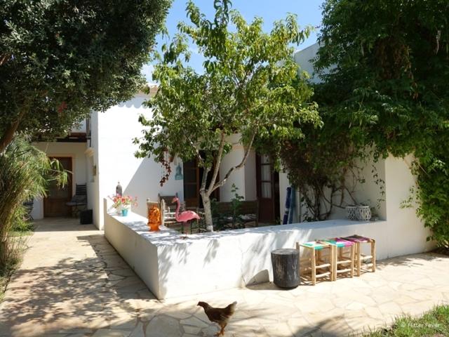La Hacienda Ibiza patio with chicken