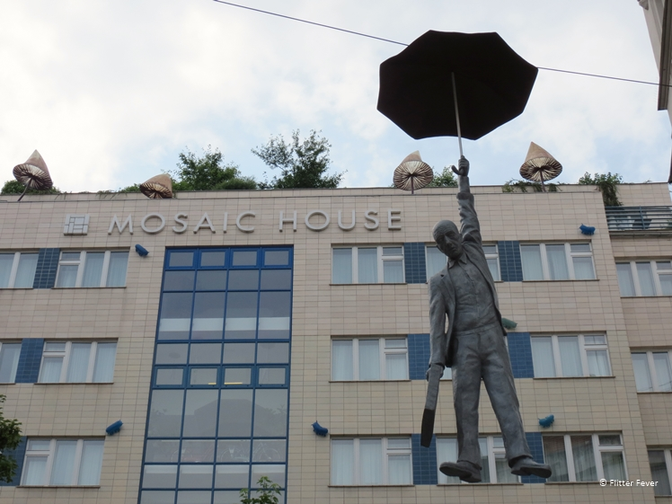 Umbrella man hanging on wire at Mosaic House Prague