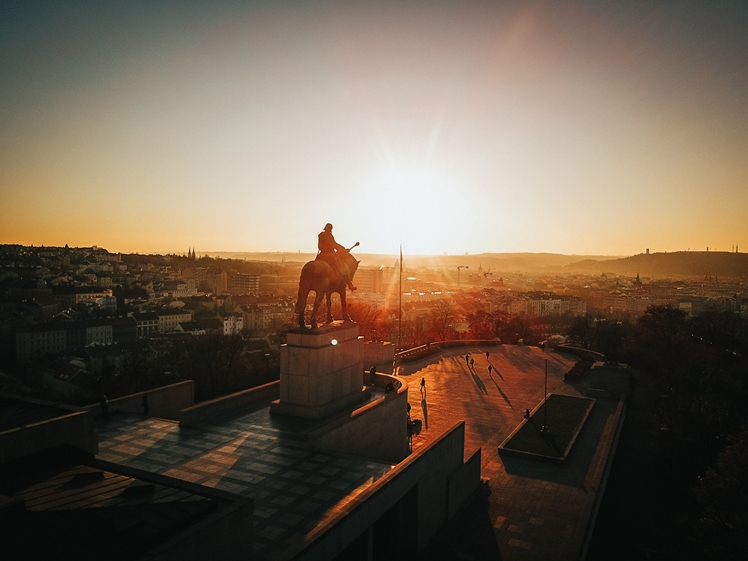 Statue man on horse in Prague at sunset