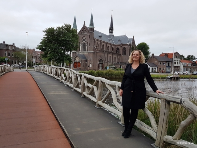 At the bicycle bridge with the St Jozef Church in Alkmaar