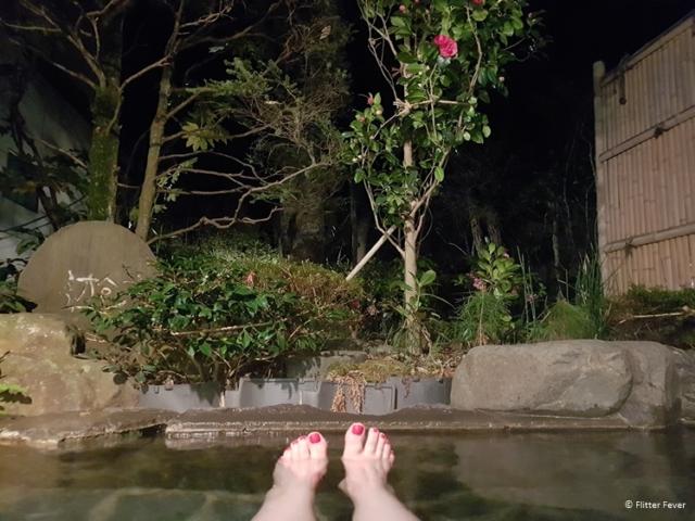 Bathing outdoor onsen at night in Japan Yudanaka Yumoto