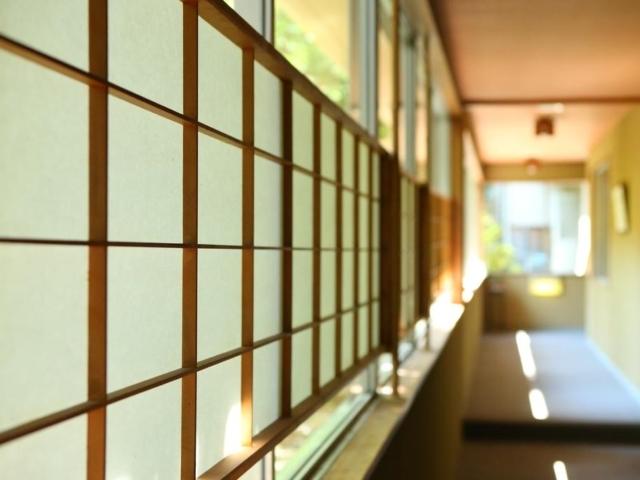 Hall way of ryokan with room dividers of paper and wood at Yudanaka Yumoto