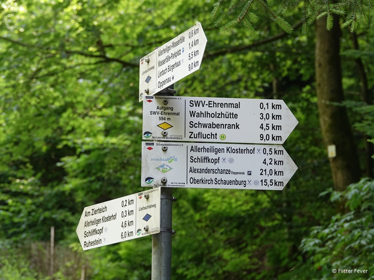 Road signs at walking path between All Saints monastery ruin and waterfall Black Forest