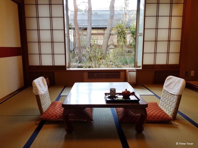Tatami area with two zaizu chairs and low salon table at Yudanaka Yumoto