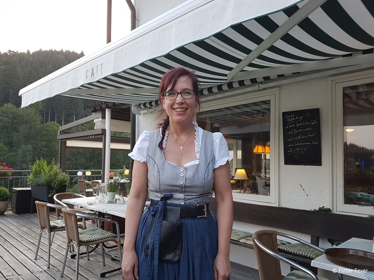 Waitress in dirndl at landhaus Eickler in Baiersbronn