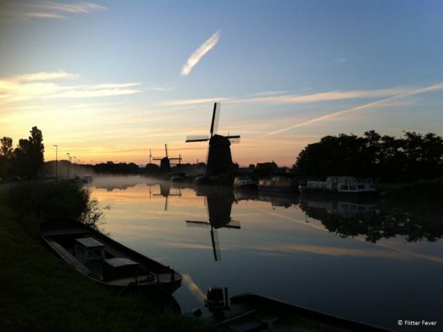 Windmills at Hoornse Vaart, Alkmaar on an early, foggy morning