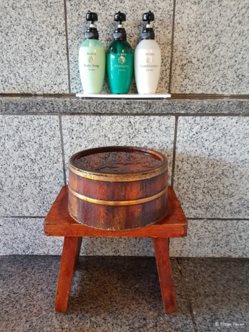 Wooden stool, bucket and bathing amenities at Fuki no Mori onsen
