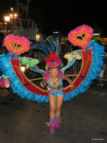 Happy lady with wings on the street parade in Willemstad Cuaraco